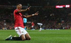 Marcus Rashford celebrates scoring Manchester United's third.