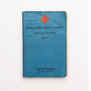 A pocket-sized First Aid Manual, printed by the British Red Cross in 1912