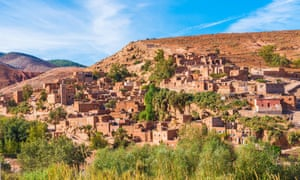 A Berber village nestled into the Atlas mountains, the buildings the same russet colour as the mountains