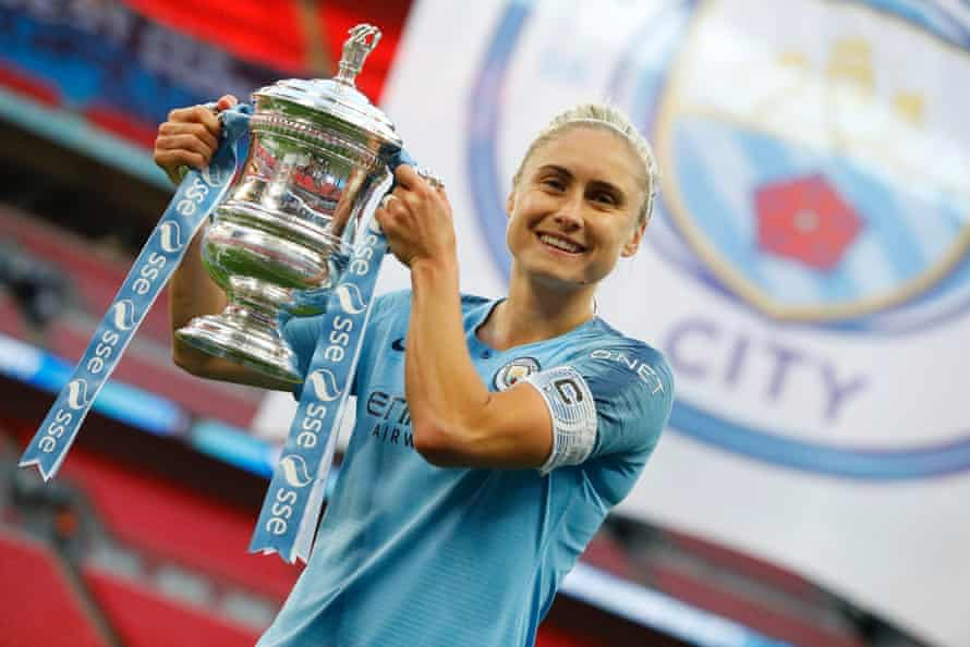 Steph Houghton holds the trophy aloft.