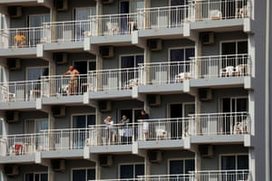 People in the sun on balconies of an apartment hotel on the on Costa del Sol