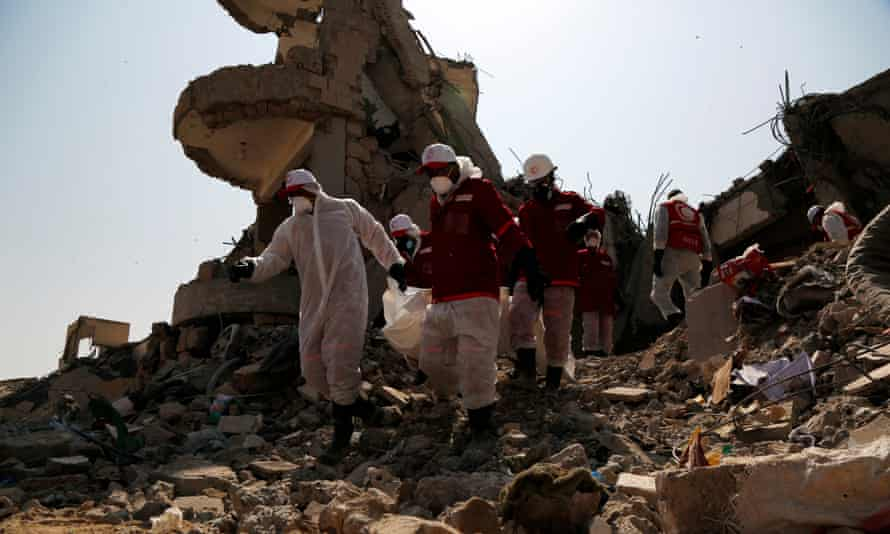 A rescue team searches for victims among the rubble of a building hit by airstrikes, in Dhamar province, Yemen, on 4 September 2019.