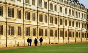 Students walk by Clare College Old Court, Cambridge University.