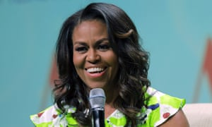 """FILE - In this June 22, 2018 file photo, former first lady Michelle Obama speaks at the American Library Association annual conference in New Orleans. Obama is launching a book tour to promote her memoir """"Becoming,"""" a tour featuring arenas and other performing centers to accommodate crowds likely far too big for any bookstore. (AP Photo/Gerald Herbert)"""