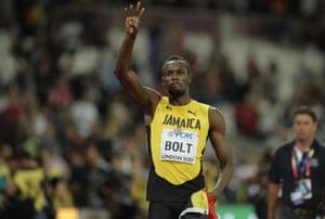 Jamaica's Usain Bolt waves to the crowd.