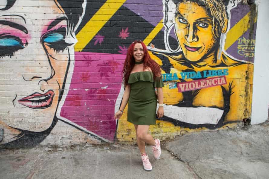Daniela Maldonado Salamance, director of Red Comunitaria Trans, in Santa Fe in front of a wall that reads: 'A life free of violence.'