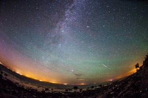 Fehmarn, Germany Meteors from the Perseid meteor swarm burn up in the atmosphere as our own galaxy, the Milky Way, is seen in the clear night sky