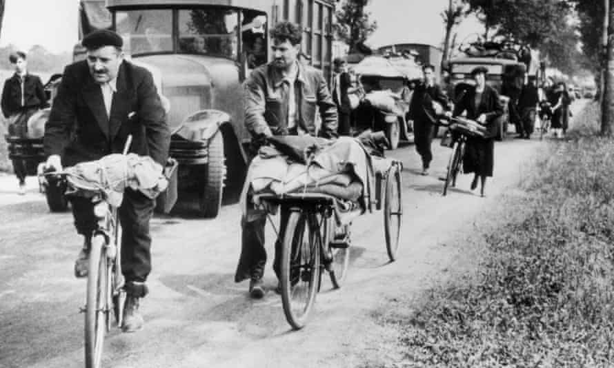 People with loaded bicycles and trucks during the evacuation of Paris in 1940