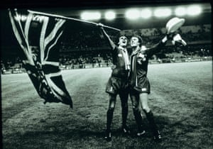 Thompson and Neal celebrate the victory with the help of a large flag