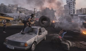 Protesters in Beirut unloading tyres to burn during unrest sparked by economic difficulties
