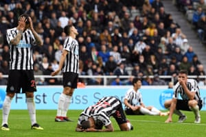 August 26: Deandre Yedlin of Newcastle United and his teammates look dejected after his own goal against Chelsea.