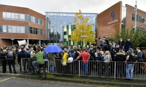 A large crowd of people outside Richard Rose Central Academy