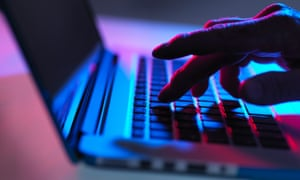 A hand hovering over a keyboard