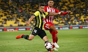 Louis Fenton of Wellington Phoenix clears the ball under pressure from Moudi Najjar of Melbourne City in their A-League clash.
