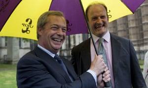 Nigel Farage, left, and Douglas Carswell share a Ukip umbrella.
