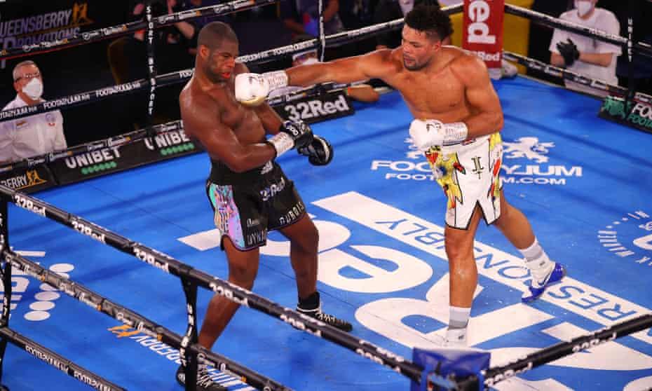 Joe Joyce punches Daniel Dubois during their fight in London in November last year.