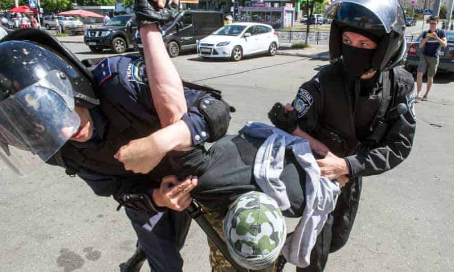 Riot police arrest a right-wing activist during a protest against the first 'march of equality' parade in Kiev.