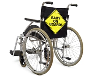 Wheelchair with 'Baby On Board' sign on back