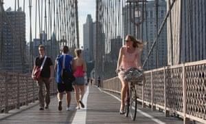 Walkers and cyclists cross the Brooklyn Bridge in New York, where many of the city's car-centric policies were redrawn under Mayor Michael Bloomberg.