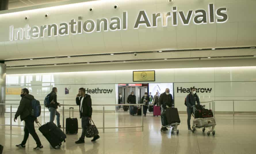 Travellers arriving at Heathrow airport's Terminal 2 on Monday.