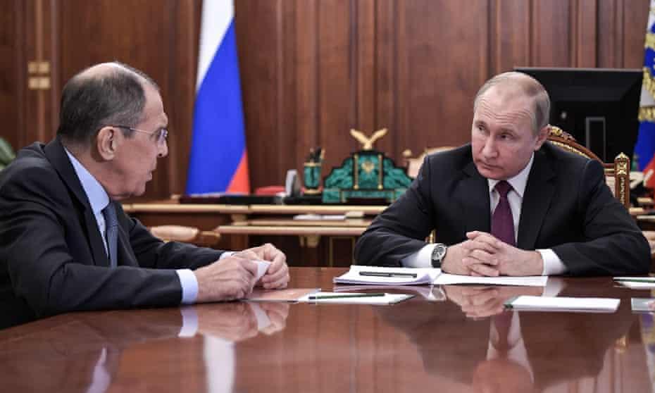 Sergei Lavrov and Vladimir Putin during a meeting at the Kremlin