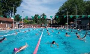 Londoners enjoy a swim in London Fields, Hackney.