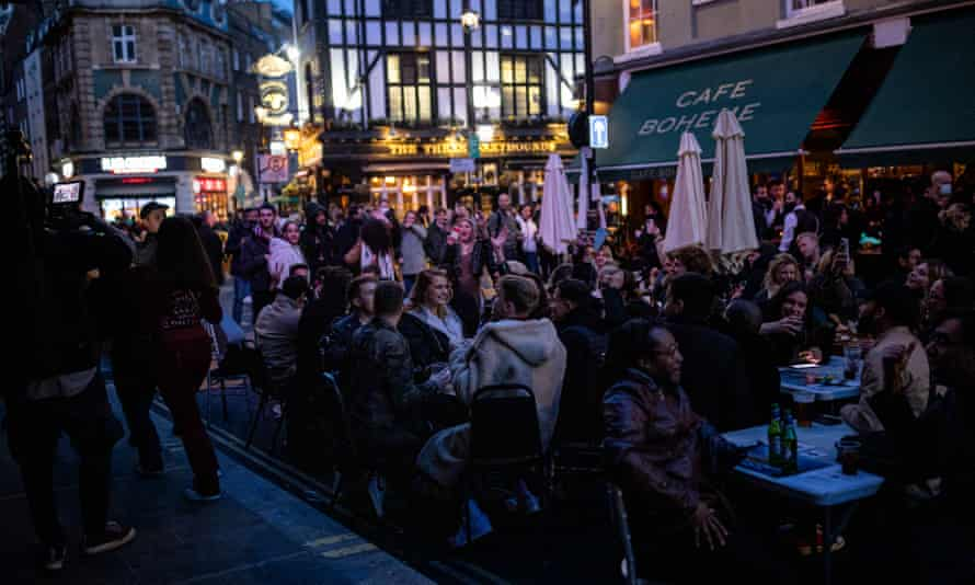 'There was sunshine and a sense of joyfulness in the streets. People were laughing out loud and drinking together and cheersing.' People socialising in Soho on 16 April