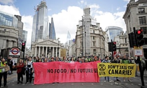Extinction Rebellion climate change protesters block a road in the City of London.