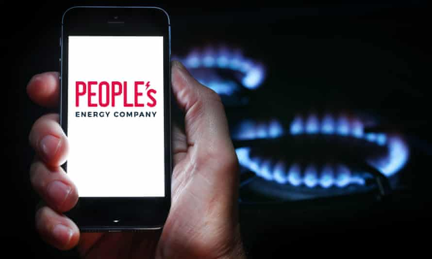 A man looking at the People's Energy Company on his mobile phone