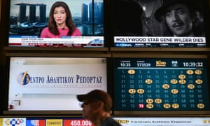 Greece has awarded four national TV licences in a controversial auction.