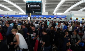 People at the British Airways check-in desks at Heathrow at the height of the outage.