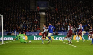 Aston Villa's goalkeeper Orjan Nyland stops a shot by Leicester City's James Maddison.