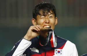Son Heung-min celebrates after winning gold at at the Asian Games in Indonesia in September 2018.