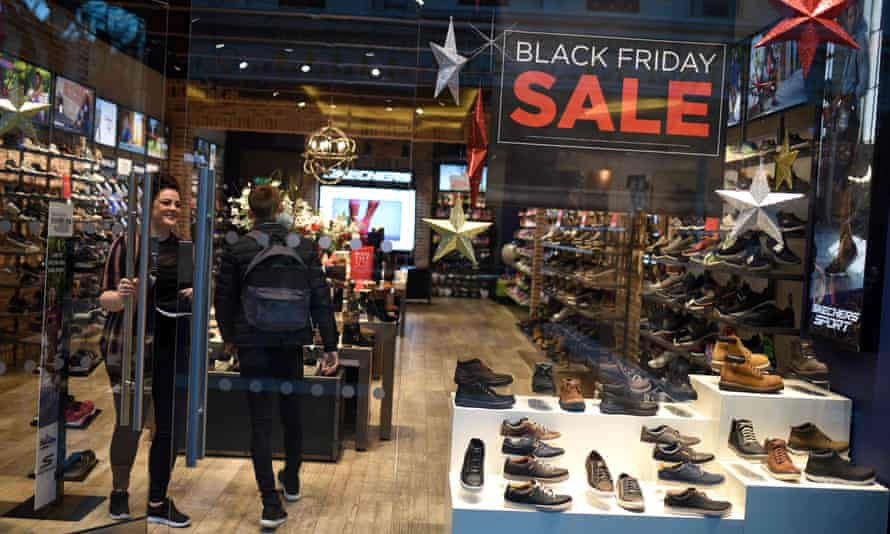 Lone Black Friday shopper enters empty shoe store in the Trafford Centre, Manchester
