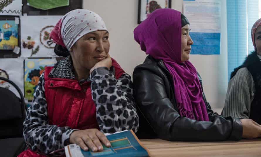 Workers with Ak-Zhar local government during a staff meeting