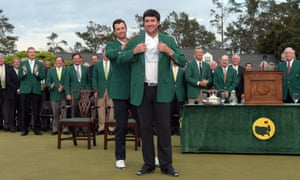 Adam Scott presents Bubba Watson with the Green Jacket – his second – in 2014.