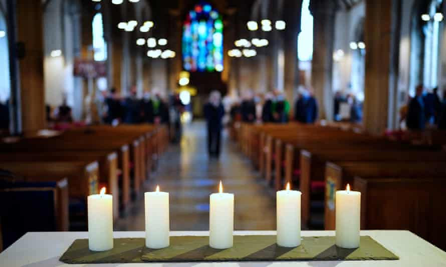 A civic service is held at St Andrew's church in Plymouth on Wednesday to remember the people killed in the shooting.