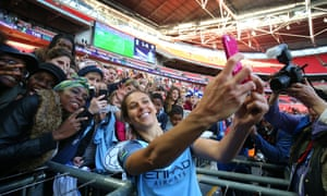 Carli Lloyd takes a selfie with the fans.