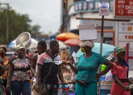 A woman sells hand sanitiser at the Makola market, Accra.