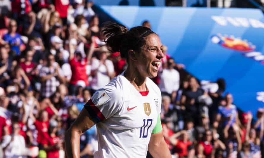 Carli Lloyd celebrates scoring the opening goal against Chile, the first of her two in the USA's 3-0 win
