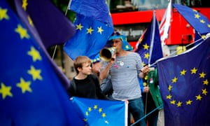 Pro-EU demonstrators hold placards and wave European Union flags during an anti-Brexit protest outside the Houses of Parliament.