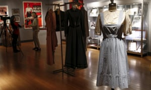 The pinafore dress worn by Judy Garland in The Wizard of Oz stands among a host of other memorabilia at Bonhams in New York.