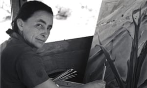 Georgia O'Keeffe painting in her car at Ghost Ranch, New Mexico.