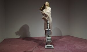 An Ivanka Trump lookalike vacuums crumbs thrown by spectators at Jennifer Rubell's art exhibit Ivanka Vacuuming 2019.