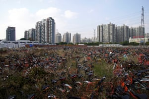 Abandoned bicycles from various bike-sharing services in Shanghai