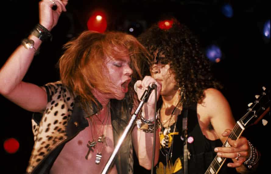 Axl Rose and Slash onstage in LA in 1986.