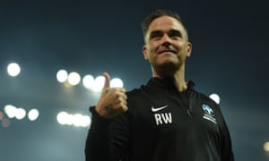 Robbie Williams celebrates after the Soccer Aid charity football match.
