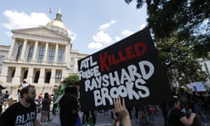 Protesters march near the Georgia Capitol after Atlanta police shot and killed Rayshard Brooks.