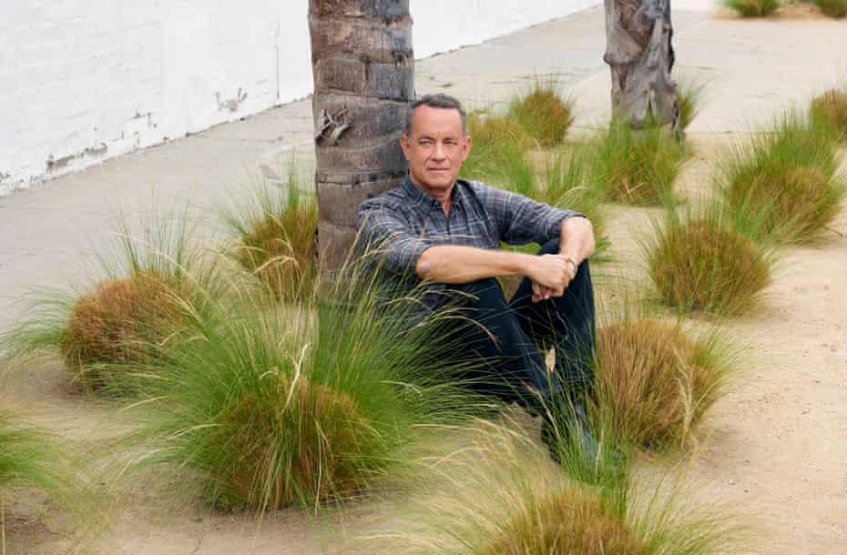 Tom Hanks sitting by a palm tree