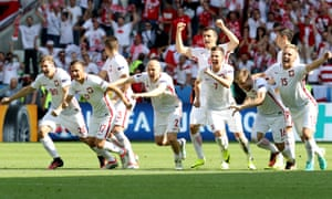 Poland's players celebrate their 5-4 penalty shootout win against Switzerland in Saint-Etienne